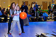Jackie Harrigan helps her daughter Megan Harrigan bowl during the bowling party held for Contestants in the Scripps Spelling Bee. Photo by: Ross Brinkerhoff.