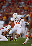October 01, 2011: Texas Longhorns kicker Justin Tucker (19) kicks from the hold of Texas Longhorns holder Cade McCrary (86) during the first half of the game between the Iowa State Cyclones and the Texas Longhorns at Jack Trice Stadium in Ames, Iowa on Saturday, October 1, 2011. Texas defeated Iowa State 37-14.
