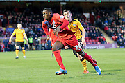 York City forward, on loan from Burnley, Ntumba Mabssanka  sprints away from Newport County midfielder, on loan from Crystal Palace, Connor Dymond  during the Sky Bet League 2 match between York City and Newport County at Bootham Crescent, York, England on 16 January 2016. Photo by Simon Davies.