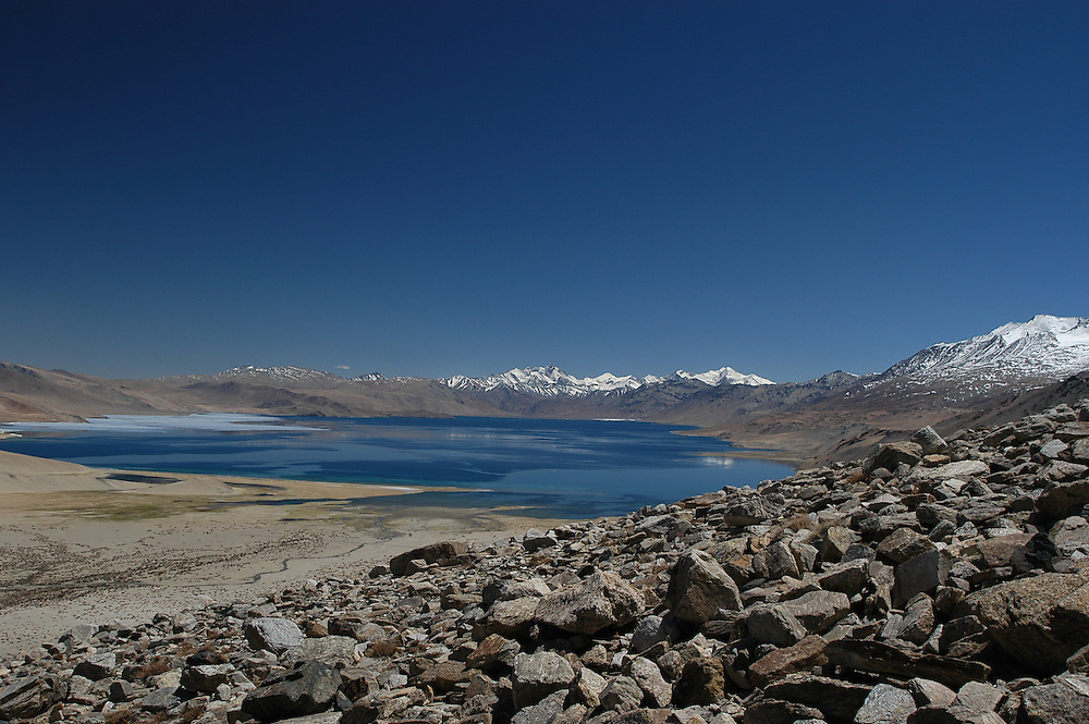 Tso (Lake) Moriri rests at 15,000ft on Ladakh's Changtang Plateau. Nestled into the western side is the village of Korzok.  Korzok is the nomadic headquarters of the region and the pastures nearby are a seasonal home in the Spring and Fall seasons.