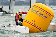 Adam Beattie (AUS987) gets tangled in tne top mark in race seven of the A Class World championships regatta being sailed at Takapuna in Auckland. 15/2/2014