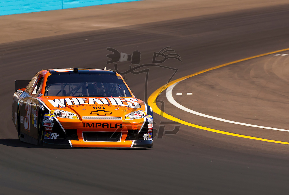 AVONDALE, AZ - MAR 03, 2012:  Jeff Burton (31) brings his NASCAR Sprint Cup car through turn 4 during qualifying for the Subway Fresh Fit 500 race at the Phoenix International Raceway in Avondale, AZ.