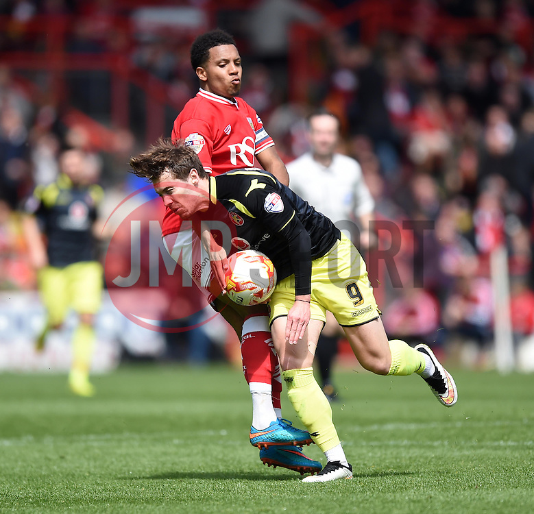 Bristol City's Korey Smith battles for the ball with Walsall's Tom Bradshaw - Photo mandatory by-line: Paul Knight/JMP - Mobile: 07966 386802 - 03/05/2015 - SPORT - Football - Bristol - Ashton Gate Stadium - Bristol City v Walsall - Sky Bet League One