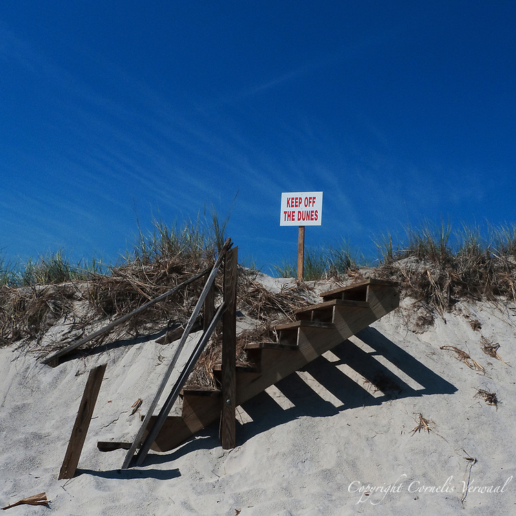 Stairs to nowhere in the eroded dunes of Fire Island.