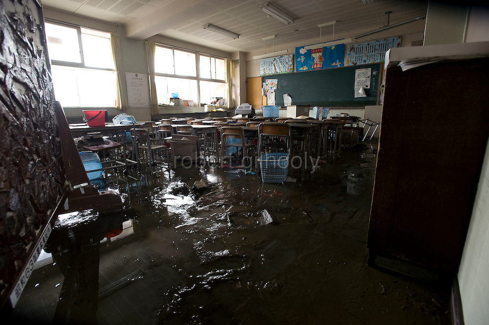 The classroom floor  of an elementary school is caked in sludge following the March 11 quake and tsunami  in Ishinomaki, Japan on 15 March, 2011.  Photographer: Robert Gilhooly