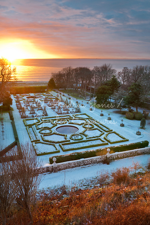 Sunrise over the North Sea and the West Parterre in winter<br /> <br /> Dunrobin Castle, Sutherland, Scotland