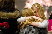 Mourners embrace during the community memorial vigil at Ben Lomond High School in Ogdenfor Emilie Parker, one of the children murdered during the recent school shooting at Sandy Hook Elementary, Thursday, Dec. 20, 2012