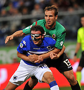 A masked Pazzini of Inter Milan is challenged from behind by Portanova. 24th October 2009.