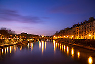 The Pont Marie over the Seine and the Il St Louis at dusk; Paris, France, Europe