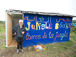 © Licensed to London News Pictures. 30/08/2015. Calais, France. William Burn, from Manchester, is a teacher at the Jungle Books, a library in the centre of the refugee camp in Calais, opened by British teacher Mary Jones where refugees take lessons in English and French among others. Tomorrow the French PM, Manuel Valls, will visit the day centre Jules Ferry at the camp. Photo credit : Isabel Infantes/LNP