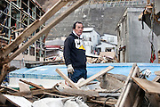 Fisherman Toshiyuki Maekawa stands in front of one of his boats in the historic city of Kamaishi, Iwate Prefecture, Japan on 04 April, 2011. .Photographer: Robert Gilhooly