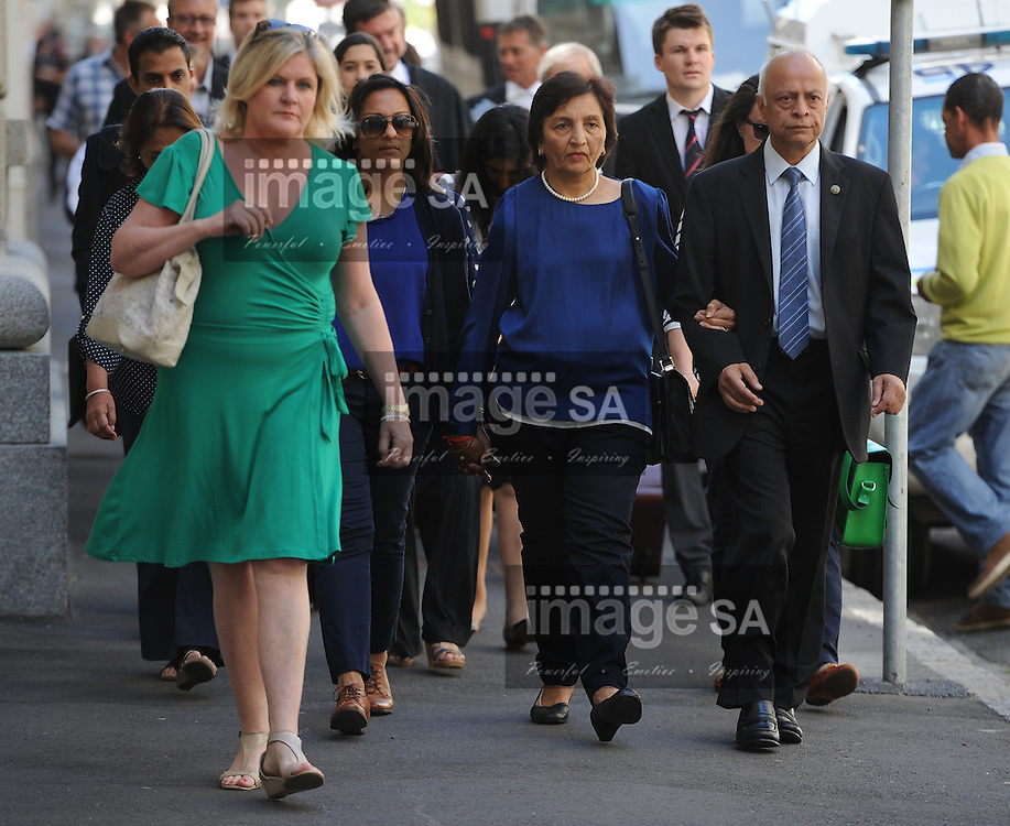 CAPE TOWN, SOUTH AFRICA - Monday 13 October 2014, Prakash and Snila Dewani, parents of Shrien Dewani, arrive at court during Day 5 of the Shrien Dewani trial at the Western Cape High Court before Judge Jeanette Traverso. Dewani is caused of hiring hit men to murder his wife, Anni. Anni Ninna Dewani (n&eacute;e Hindocha; 12 March 1982 &ndash; 13 November 2010) was a Swedish woman who, while on her honeymoon in South Africa, was kidnapped and then murdered in Gugulethu township near Cape Town on 13 November 2010 (wikipedia).<br /> Photo by Roger Sedres