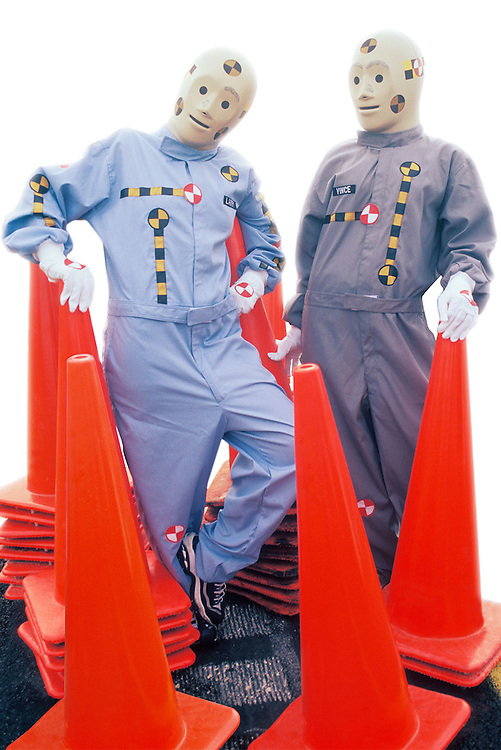 "Portrait of two crash dummies with orange safety cones, ""Vince"" & ""Larry"""