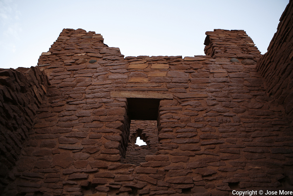 The Wukoki Pueblo Ruins near Flagstaff, Arizona, are just one of several ancient pueblo communities built from Moencopi sandstone. The ruins are within the Wupatki National Monument that were inhabited by the Sinaqua Indians from about 1100AD to 1250AD when they mysteriously left the area. Other pueblo sites within the Monument include Wupatki, Citadel, Nalakihu and Lomaki.<br /> Photography by Jose More