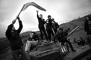 "Teenagers celebrate armenian victory on a memorial tank near Shushi. This image is part of the photoproject ""The Twentieth Spring"", a portrait of caucasian town Shushi 20 years after its so called ""Liberation"" by armenian fighters. In its more than two centuries old history Shushi was ruled by different powers like armeniens, persians, russian or aseris. In 1991 a fierce battle for Karabakhs independence from Azerbaijan began. During the breakdown of Sowjet Union armenians didn´t want to stay within the Republic of Azerbaijan anymore. 1992 armenians manage to takeover ""ancient armenian Shushi"" and pushed out remained aseris forces which had operate a rocket base there. Since then Shushi became an ""armenian town"" again. Today, 20 yeras after statement of Karabakhs independence Shushi tries to find it´s opportunities for it´s future. The less populated town is still affected by devastation and ruins by it´s violent history. Life is mostly a daily struggle for the inhabitants to get expenses covered, caused by a lack of jobs and almost no perspective for a sustainable economic development. Shushi depends on donations by diaspora armenians. On the other hand those donations have made it possible to rebuild a cultural centre, recover new asphalt roads and other infrastructure. 20 years after Shushis fall into armenian hands Babies get born and people won´t never be under aseris rule again. The bloody early 1990´s civil war has moved into the trenches of the frontline 20 kilometer away from Shushi where it stuck since 1994. The karabakh conflict is still not solved and could turn to an open war every day. Nonetheless life goes on on the south caucasian rocky tip above mountainious region of Karabakh where Shushi enthrones ever since centuries."