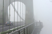 © Licensed to London News Pictures. 11/12/2013. London, UK. Hammersmith Bridge.  Fog along the banks of the River Thames in Hammesmith, West London this morning 11th December 2013 . Photo credit : Stephen Simpson/LNP