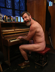 NOTE NUDITY Pianist Luke Meredith taking part in London's first nudist pub singalong at the Coach And Horses in Soho.