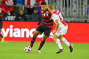 Flamengo midfielder Vitor Gabriel (54) and Ajax midefielder Dani De Wit (30) in action during a Florida Cup match at Orlando City Stadium on Jan. 10, 2019 in Orlando, Florida. <br /> Flamengo won in penalties 4-3.<br /> <br /> ©2019 Scott A. Miller