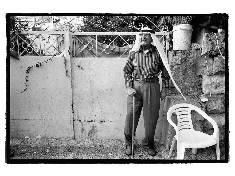 The 78 year old grandfather of the al-Ghawi family stares at his former family home. Still wearing slippers and forced to live on the streets after he and his entire family was evicted from their family home.