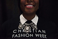 Fashion blogger and stylist Genelle L. Frazier dresses up her Christian Fashion Week T-shirt with a splashy necklace while volunteering backstage. Christian Fashion Week 2015 culminated with designer fashion during a runway show at The Vault in Tampa, Fla. (Photo by MELISSA LYTTLE / 2/20/15)