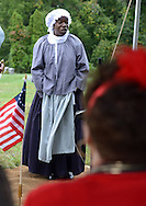 "SHANNAH08P<br /> Euell Aira Nielsen of Lansdowne, Pennsylvania, portraying Hannah Till, addresses the crowd during a dedication ceremony honoring Hannah Till Saturday October 3, 2015 at Eden Cemetery in Collingdale, Pennsylvania. Hannah Till, a free black woman and unsung hero of the Revolutionary War who worked for Gens. George Washington and Lafayette is being honored as a ""Patriot"" by the Daughters of the American Revolution with a special ceremony and headstone dedication at Eden Cemetery, a historically-black cemetery in Collingdale. (William Thomas Cain/For The Inquirer)"