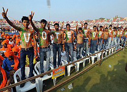 61101617<br /> Supporters of India's opposition Bharatiya Janata Party (BJP) prime ministerial candidate Narendra Modi stand with their bodies painted at a youth convention in Ahmadabad, India, Feb. 20, 2014. The general elections are scheduled to be held this year, Thursday, 20th February 2014. Picture by  imago / i-Images<br /> UK ONLY