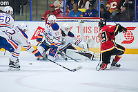 PENTICTON, CANADA - SEPTEMBER 17: Dylan Wells #30 of Edmonton Oilers deflects a shot by Dillon Dube #59 of Calgary Flames on September 17, 2016 at the South Okanagan Event Centre in Penticton, British Columbia, Canada.  (Photo by Marissa Baecker/Shoot the Breeze)  *** Local Caption *** Dylan Wells; Dillon Dube; Kyle Jenkins;