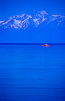 Couple sea kayaking on Lake Tahoe, CA.