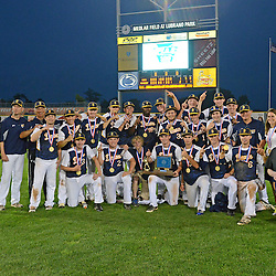 Staff photos by Tom Kelly IV<br /> Devon Prep players, coaches, and other staff pose with the trophy following the Devon Prep vs Elk County Catholic in the PIAA single A Championship game in State College on Friday afternoon, June 13, 2014 due to a rain storm moving through.