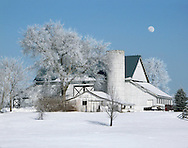 A Barn In Winter, With Snow Covering Everything Including The Limbs Of Trees And A Nearly Full Moon Visible In A Blue Sky, Southwestern Ohio, USA : Low Res File - 8X10 To 11X14 Or Smaller, Larger If Viewed From A Distance