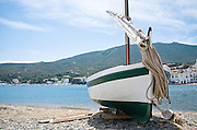 A wooden sailboat on the beach in Cadaques, Spain, 2009