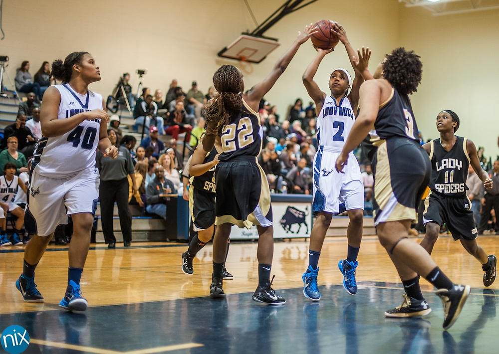 Hickory Ridge's Jiera Shears (2) takes a shot against Concord Friday night at Hickory Ridge High School in Harrisburg. The Lady Bulls won the game 47-38.