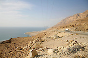 truck following the desert road along the dead sea
