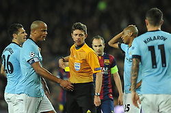Dejected Manchester City players surround referee, Gianluca Rocchi - Photo mandatory by-line: Dougie Allward/JMP - Mobile: 07966 386802 - 18/03/2015 - SPORT - Football - Barcelona - Nou Camp - Barcelona v Manchester City - UEFA Champions League - Round 16 - Second Leg