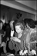Margaret Thatcher buying tickets on the tombola, Blue Ball,  Hurlingham, London. 26 June 1983.