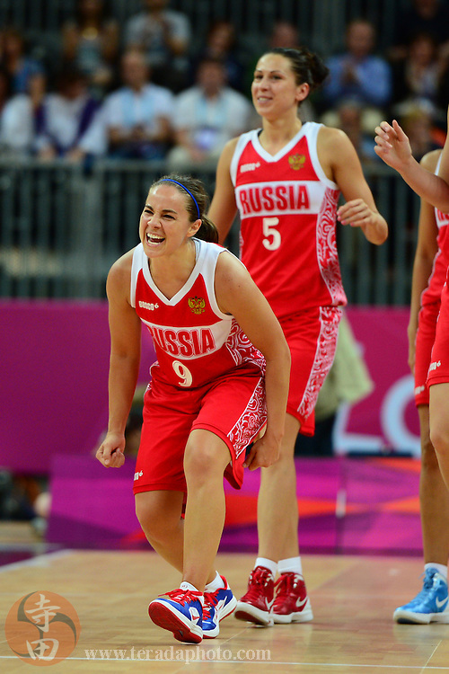 Jul 28, 2012; London, United Kingdom; Russia guard Becky Hammon (9) and guard Evgeniya Belyakova (5) celebrate after the game against Canada at Basketball Arena. Russia defeated Canada 58-53.