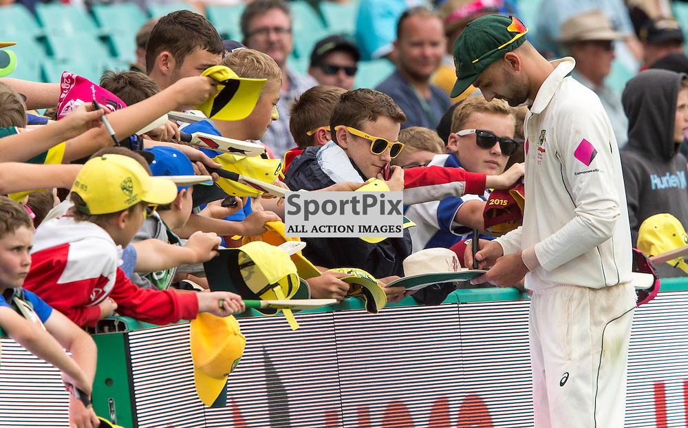 3rd Test Match 2015-16 Day 1, Australia v West Indies, Sydney Cricket Ground; 3 January 2016<br /> Australian Nathan Lyon signs souvenirs for the Australian fans