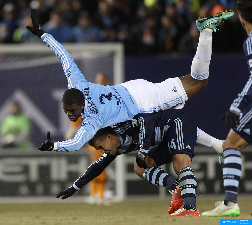 Kwame Watson-Siriboe, (top), NYCFC, and Dom Dwyer, Sporting KC, challenge for the ball during the New York City FC Vs Sporting Kansas City, MSL regular season football match at Yankee Stadium, The Bronx, New York,  USA. 27th March 2015. Photo Tim Clayton