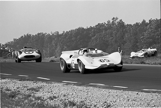 Jim Hall in his Chaparral 2 at Watkins Glen in 1965 leads Augie Pabst in one of the original, front-engined Chaparral 1 cars and the other Chaparral 2, driven by Hap Sharp.
