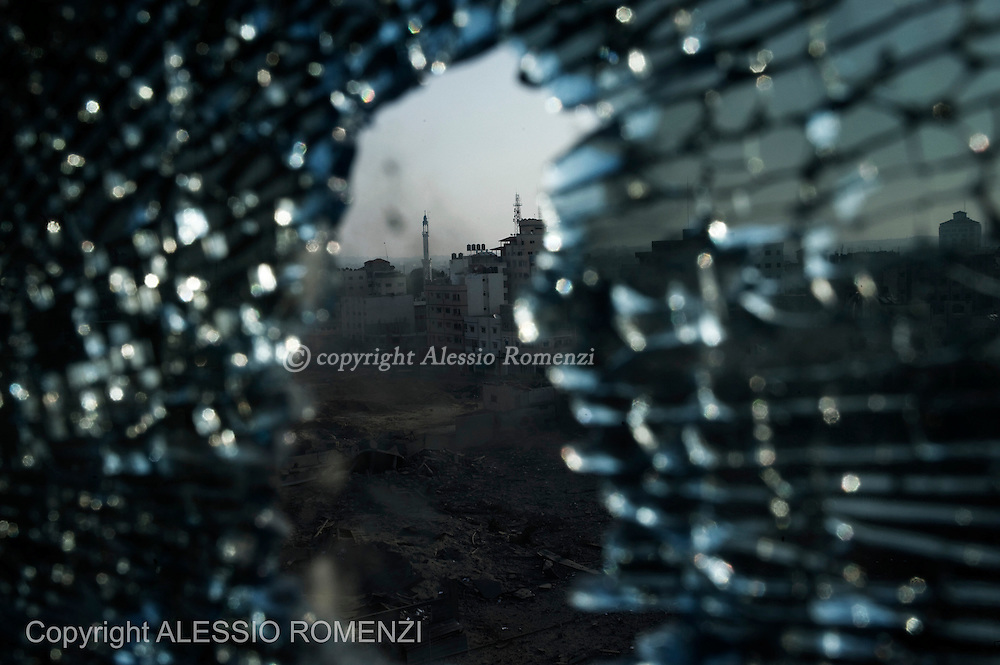 Gaza City: Genera view of Gaza City center took through a window damaged by Israeli airstrike. November 19, 2012. ALESSIO ROMENZI