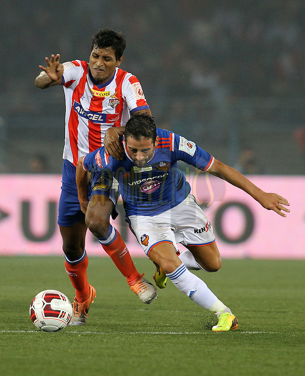Arnab Kumar Mondal of Atletico de Kolkata and Edgar Carvalho Figueira Marcelino of FC Goa in action during match 55 of the Hero Indian Super League between Atletico de Kolkata and FC Goa held at the Salt Lake Stadium in Kolkata, West Bengal, India on the 10th December 2014.<br /> <br /> Photo by:  Vipin Pawar/ ISL/ SPORTZPICS