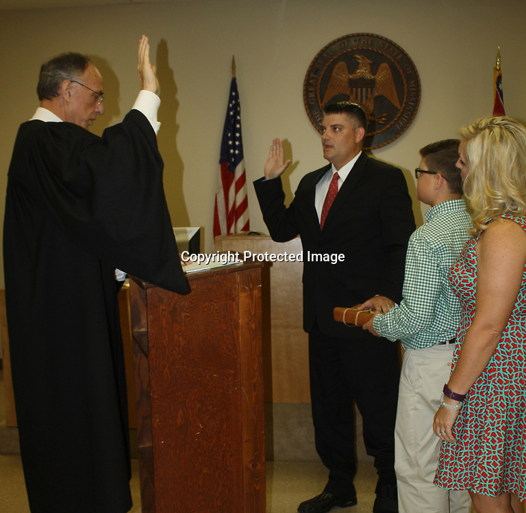 EMILY TUBB/BUY AT PHOTOS.MONROECOUNTYJOURNAL.COM<br /> Judge Mike Malski swears in Amory Mayor Brad Blalock June 26 to his second term of office during a ceremony at the Monroe County Government Complex. Blalock is joined by his son, Cooper, and his wife, Candy. Other elected officials sworn in were aldermen, Joe McGonagill, Buddy Carlisle, John Darden, Tony Poss and Glen Bingham, and chief of police, Ronnie Bowen.