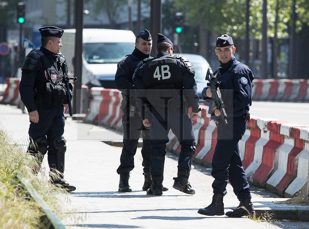 © Licensed to London News Pictures . 09/05/2017. Paris, France . Armed police at the scene where French police have cleared approximately 1000 people from an ad hoc roadside camp under roadways along a central reservation , in which migrants were living , in Porte de la Chapelle in North Paris , this morning (9th May 2017) . Photo credit: Joel Goodman/LNP