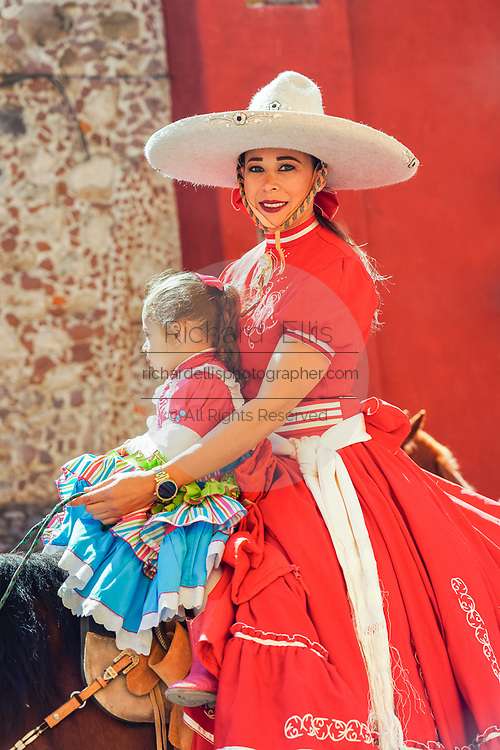 A Mexican Cowgirl and her daughter ride horseback in a parade to celebrate the 251st birthday of the Mexican Independence hero Ignacio Allende January 21, 2020 in San Miguel de Allende, Guanajuato, Mexico. Allende, from a wealthy family in San Miguel played a major role in the independency war against Spain in 1810 and later honored by his home city by adding his name.