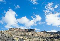 Rocky hillside cliffs made of basalt columns in central Oregon USA.