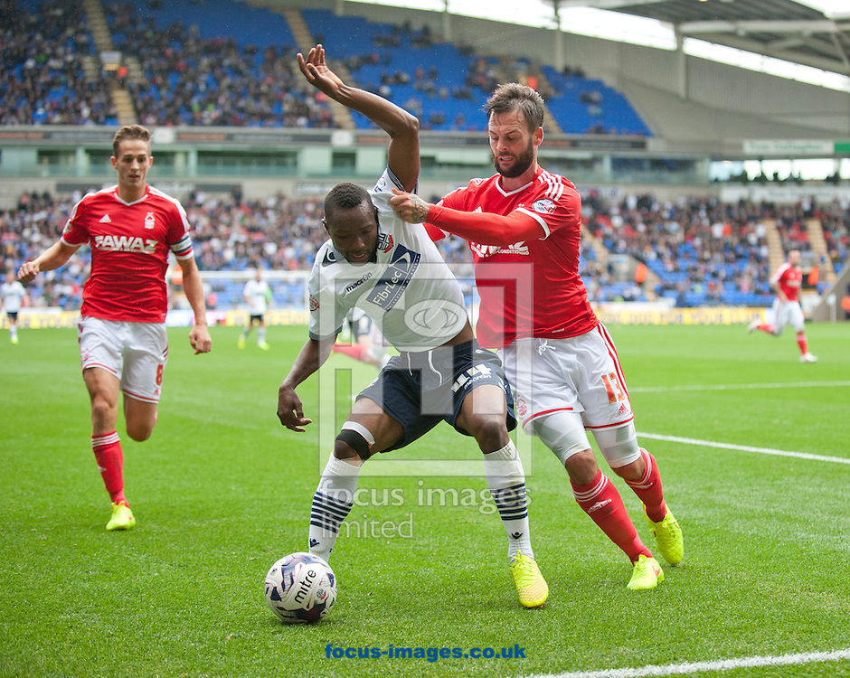 Medo Kamara of Bolton Wanderers shields the ball from Danny Fox of Nottingham Forest during the Sky Bet Championship match at the Macron Stadium, Bolton<br /> Picture by Russell Hart/Focus Images Ltd 07791 688 420<br /> 16/08/2014