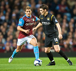 BIRMINGHAM, ENGLAND - Monday, October 5, 2009: Manchester City's Gareth Barry and Aston Villa's Stiliyan Petrov during the Premiership match at Villa Park. (Pic by David Rawcliffe/Propaganda)