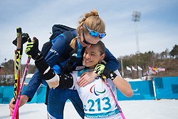 March 17, 2018 - Pyeongchang, South Korea - Oksana Masters of the US is hugged by US coach Eileen Carey after her gold medal finish in the Cross Country 5km sitting event Saturday, March 17, 2018 at the Alpensia Biathlon Center at the Pyeongchang Winter Paralympic Games. Photo by Mark Reis (Credit Image: © Mark Reis via ZUMA Wire)