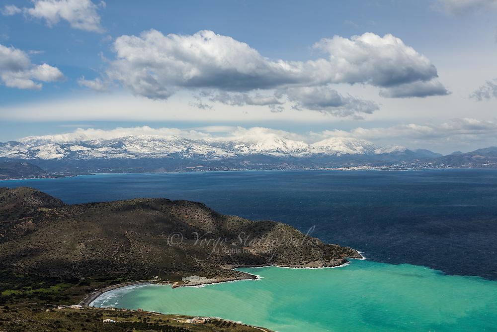 View of the mountains above Agios Nikolaos, Crete from across the Bay of Mirabello, the village of Kavousi.
