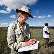 Dr. Diana H. Wall, from the Natural Resource Ecology lab at Colorado State University,  takes notes during a research trip to look at below ground animal diversity at  Kapiti Plains near Machakos, Kenya.